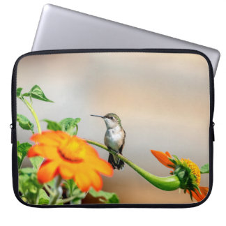 Hummingbird on a flowering plant laptop sleeve
