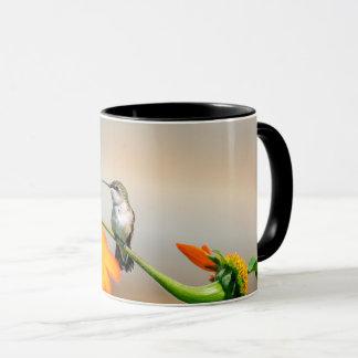Hummingbird on a flowering plant mug