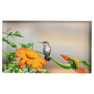 Hummingbird on a flowering plant table card holder