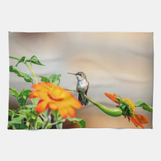 Hummingbird on a flowering plant tea towel