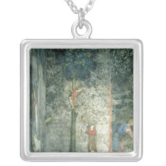Hunting dogs and men climbing a tree silver plated necklace