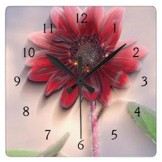 Hybrid sunflower blowing in the wind wall clocks