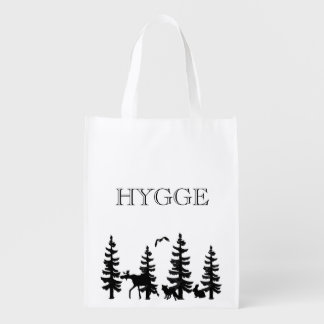 Hygge with pine trees with animals in black reusable grocery bag