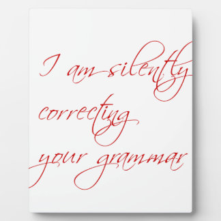 I am silently correcting your grammar-script display plaque