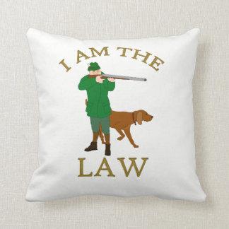 I am the law with a farmer with a gun cushion