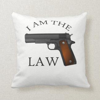 I am the law with a hand gun cushion