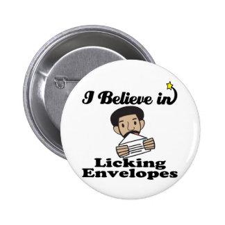 i believe in licking envelopes 6 cm round badge