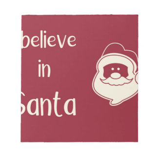 I believe in Santa words. Red background. Notepad