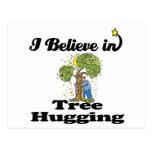 i believe in tree hugging postcard