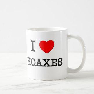 I Love Hoaxes Mugs