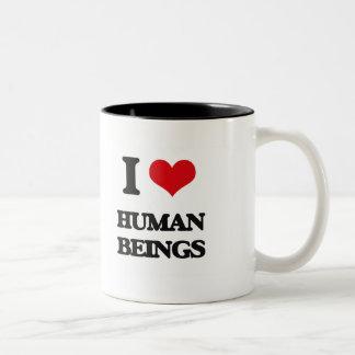 I love Human Beings Mugs