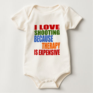 I LOVE SHOOTING BECAUSE THERAPY IS EXPENSIVE BABY BODYSUIT