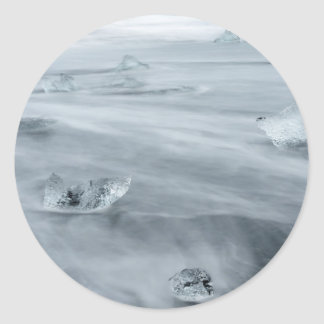 Ice and water on a beach, iceland classic round sticker