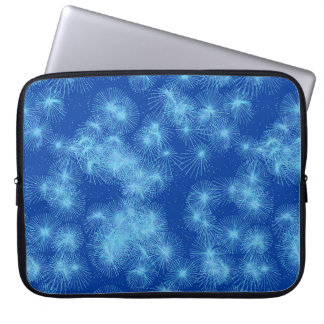 Ice crystal starbursts, blue background laptop computer sleeves