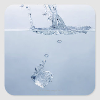 Ice cube splashing into water square sticker
