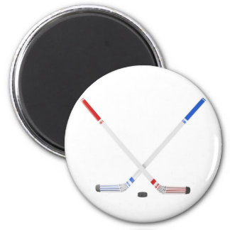 Ice hockey sticks and puck magnet