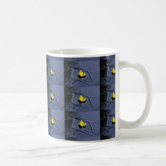 Ice in the pond with yellow maple sheet, ice form, mug