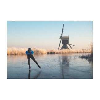 Ice skating past windmill and reeds canvas