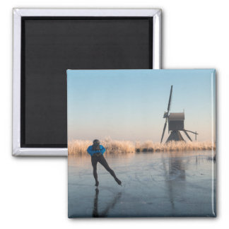 Ice skating past windmill and reeds magnet