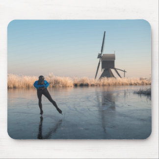 Ice skating past windmill and reeds mousepad