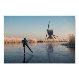 Ice skating past windmill and reeds poster