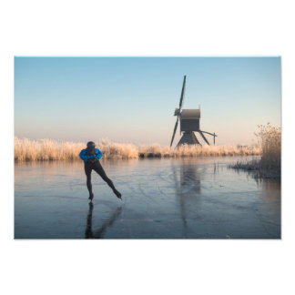 Ice skating past windmill and reeds print