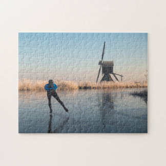 Ice skating past windmill and reeds puzzle