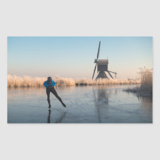 Ice skating past windmill & reed rectangle sticker