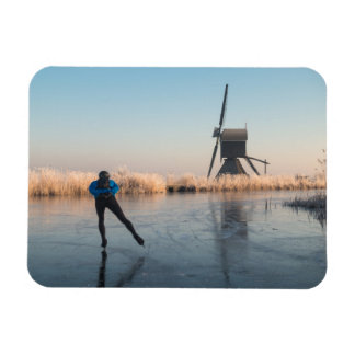 Ice skating past windmill & reeds rectangle magnet