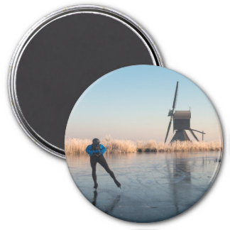 Ice skating past windmill & reeds round magnet