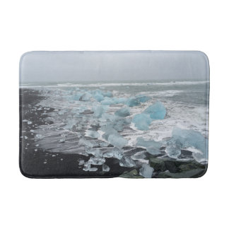 Icebergs on a black sand beach bath mat