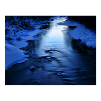 Icy and snowy river with winter blue postcard