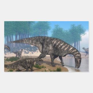Iguanodon dinosaurs herd at the shoreline rectangular sticker