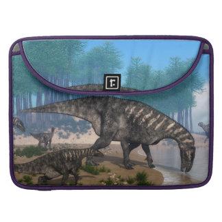 Iguanodon dinosaurs herd at the shoreline sleeve for MacBook pro