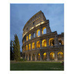 Illuminated section of the Colosseum at dusk. Poster