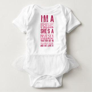 i'm a FREAK she's a WEIRDO .. Baby Bodysuit
