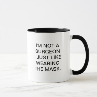 I'M NOT A SURGEON I JUST LIKE WEARING THE MASK MUG
