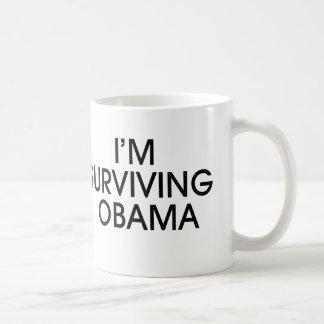 I'M SURVIVING OBAMA-black ink Coffee Mug