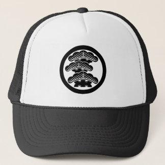 In circle the left three floor pine trucker hat
