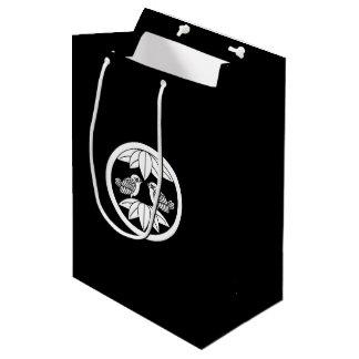 In the medium flower opposite it is in ten bamboo medium gift bag