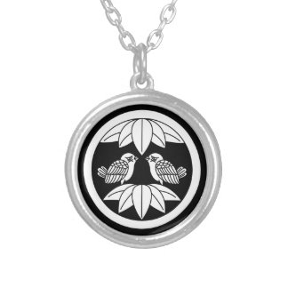 In the medium flower opposite it is in ten bamboo silver plated necklace