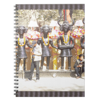 India cultural show statue of musicians artists note book