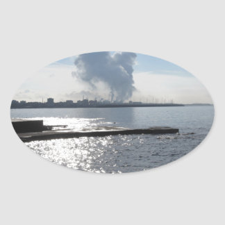 Industrial landscape along the coast oval sticker