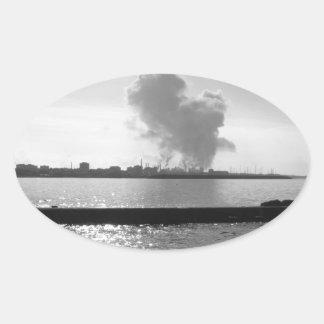 Industrial landscape along the coast oval sticker
