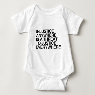 INJUSTICE ANYWHERE IS A THREAT TO JUSTICE -.png Baby Bodysuit
