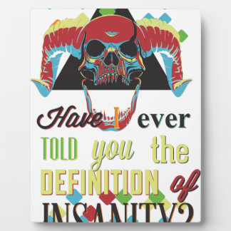 insanity and scary skull plaque