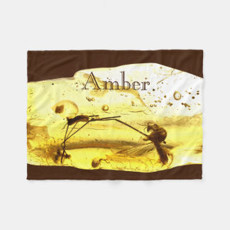 Insects in amber stone fleece blanket