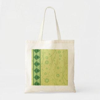 Inspiring greenish blossom on yellow texture tote bags