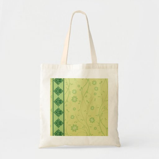 Inspiring greenish blossom on yellow texture tote bags