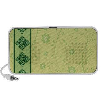 Inspiring greenish blossom on yellow texture notebook speaker